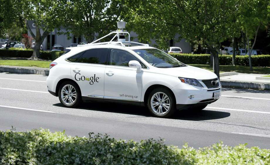 In this photo taken May 14, 2014, a Google self-driving car goes on a test drive near the Computer History Museum in Mountain View, Calif. Photo: AP Photo/Eric Risberg  / AP