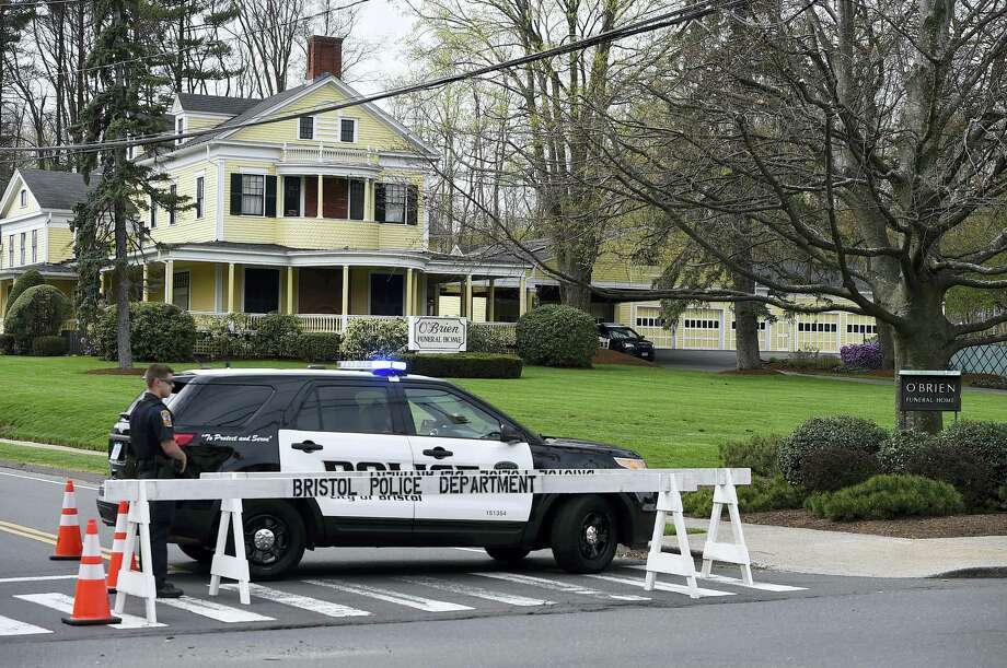 Police block the street in front of O'Brien Funeral Home for the funeral of Aaron Hernandez, Monday in Bristol. Photo: Jessica Hill — The Associated Press  / AP2017