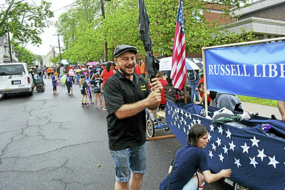 Last year's parade began with a light drizzle, but as the parade made its way along Main Street, the rain receded. Photo: Middletown Press File Photo