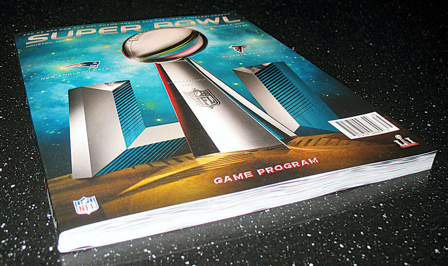 The Super Bowl LI program sits on a table at the Quad/Graphics plant in Lomira, Wis. For more than 20 years, the plant has printed the Super Bowl program. Photo: Nicholas Dettmann/West Bend Daily News Via AP   / West Bend Daily News