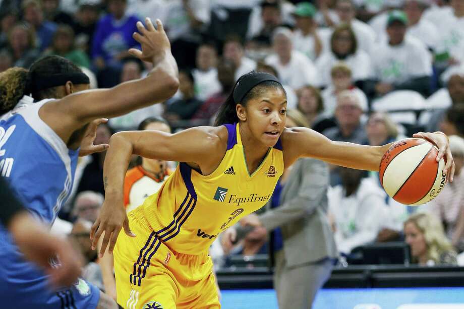 FILE - In this Sunday, Oct. 9, 2016, file photo, Los Angeles Sparks forward Candace Parker (3) controls the ball over Minnesota Lynx forward Rebekah Brunson in the first half of Game 1 of the WNBA basketball finals in Minneapolis. It doesn't seem that long ago that the Los Angeles Sparks were celebrating their first WNBA championship in 14 years with a thrilling deciding Game 5 victory over the Minnesota Lynx. Now the WNBA is set to begin its 21st season next month with training camps opening up around the league on Sunday, April 23, 2017, and Monday. Photo: AP Photo — Stacy Bengs, File In This Sunday, Oct. 9, 2016 Photo, Los Angeles Sparks Forward Canda / FR170489 AP