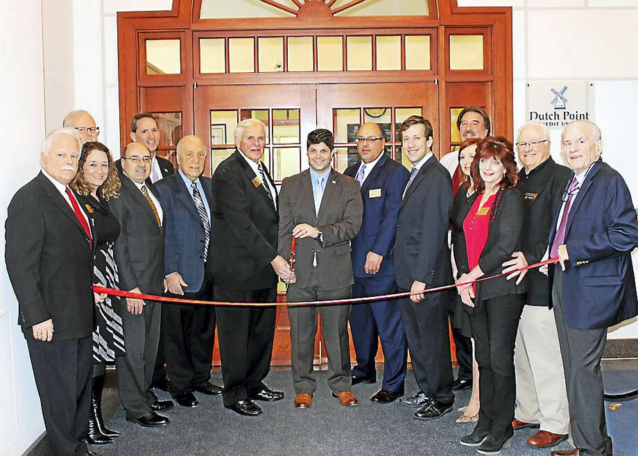 Dutch Point Credit Union held a grand opening for its Middletown branch at 213 Court St. on Feb. 15. Middlesex Chamber President Larry McHugh joined Chairman of Dutch Point Credit Union's Board of Directors Michael Dwyer, Dutch Point Credit Union President Francis Proto as well as the rest of Dutch Point Credit Union staff. Local business officials also attended, including Central Business Bureau Chairman and Middletown Small Business Development Counselor Paul Dodge. Government officials including Middletown Mayor Dan Drew, state Reps. Joe Serra and Matt Lesser and state Sen. Paul Doyle attended the grand opening. Photo: Contributed Photo