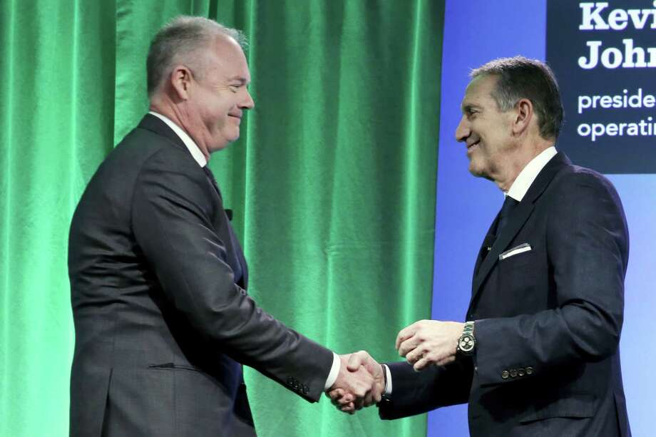 Starbucks Chairman and CEO Howard Schultz, right, introduces company President and COO Kevin Johnson during the Starbucks 2016 Investor Day meeting, in New York. Photo: Richard Drew — The Associated Press File  / AP