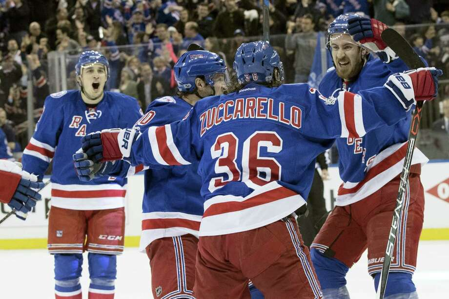 Rangers right wing Mats Zuccarello (36) celebrates with his teammates after scoring on Saturday. Photo: Mary Altaffer — The Associated Press  / Copyright 2017 The Associated Press. All rights reserved.