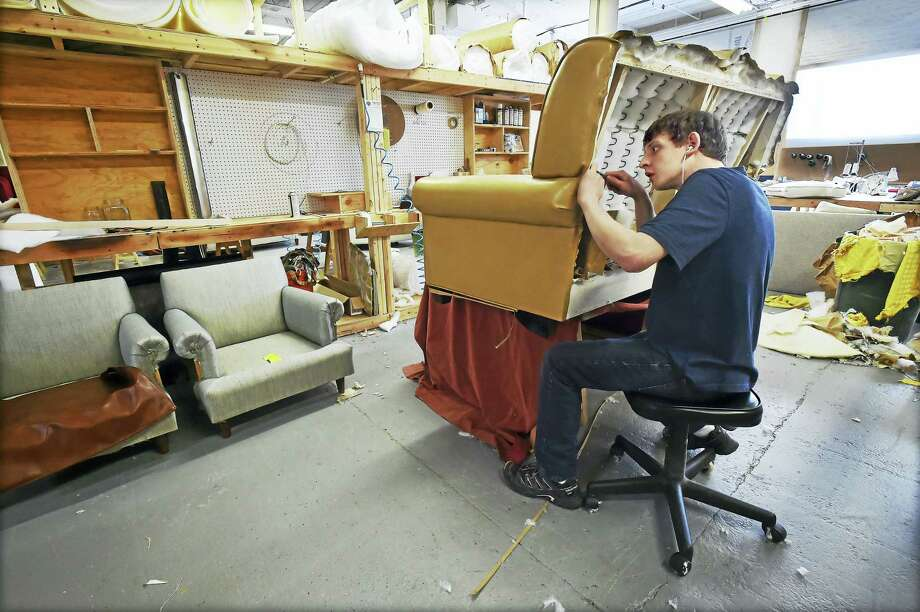 Brian Kolenda, an apprentice upholsterer at the hand-crafted furniture business, Oak & Velvet, in the workshop in the first floor of the Remington Rand building at 180 Johnson St. in Middletown. Photo: Catherine Avalone — New Haven Register  / Catherine Avalone/New Haven Register
