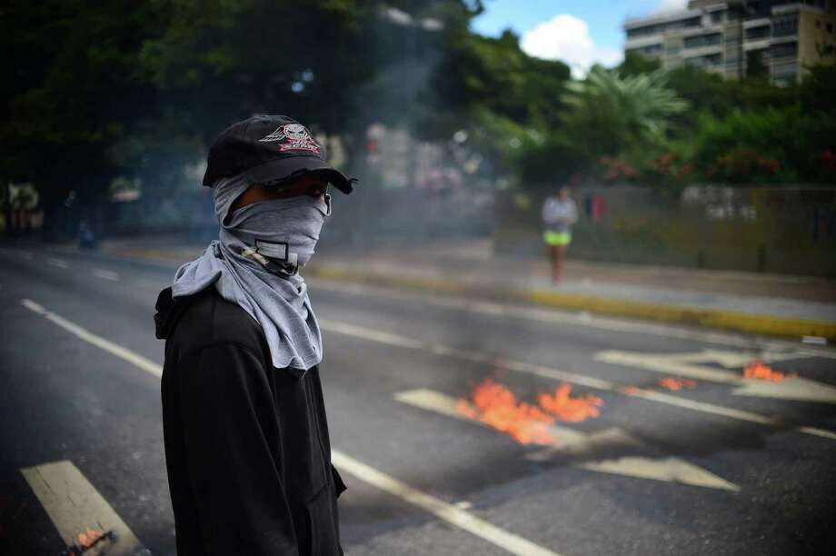 Thoughts of yesterday's Venezuela are full of joy, of feeling safe and experiencing wonder. Today, the dead pile up, stomachs are empty, and hope is elusive. Photo: Ronaldo Schemidt /AFP / Getty Images / AFP or licensors