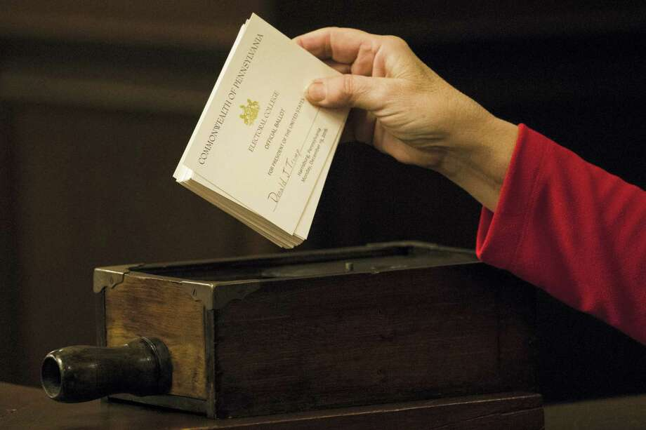 A teller places ballots into a box after tallying elector's votes during Pennsylvania's 58th Electoral College at the state Capitol in Harrisburg, Pa., Dec. 19. Photo: AP Photo — Matt Rourke   / Copyright 2016 The Associated Press. All rights reserved.