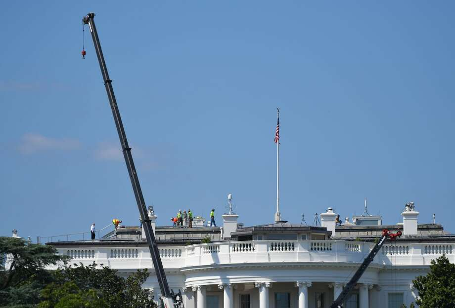 Cranes are seen infront of the south front of the White House as it undergoes renovations on August 9, 2017 in Washington, DC. / AFP PHOTO / MANDEL NGAN        (Photo credit should read MANDEL NGAN/AFP/Getty Images) Photo: MANDEL NGAN/AFP/Getty Images