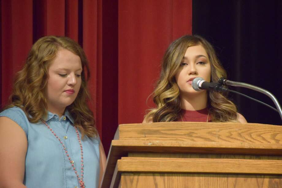 Plainview High School students Sawyer Tirey (left) and Tabbatha Riojas share the duties of mistress of ceremonies for the Plainview ISD 2017 Convocation on Friday morning.
