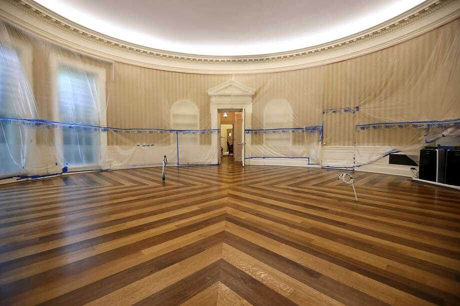 The Oval Office sits empty and the walls covered with plastic sheeting during renovation work at the White House August 11, 2017 in Washington, DC. Photo: Chip Somodevilla/Getty Images