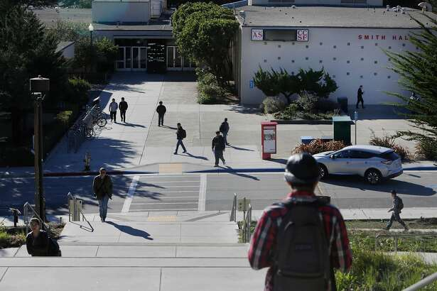 People walk across the Ocean campus at City College of San Francisco on Monday, November 16, 2015 in San Francisco, Calif.