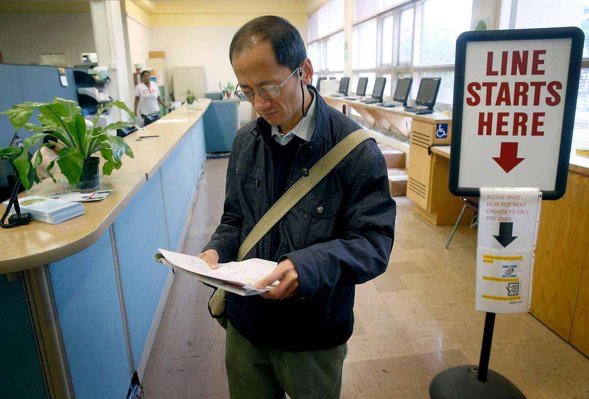 Simon Chan reviews his paperwork after discovering that he was inadvertently charged tuition fees when registering in person for a sculpting class at CCSF in San Francisco, Calif. on Wednesday, Aug. 9, 2017. The fee was refunded after the error was discovered. In an effort to boost enrollment, tuition fees will be waved for qualifying San Francisco residents for the next two academic years.
