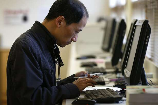 Simon Chan fills out an online form in the registration office for a sculpting class at CCSF in San Francisco, Calif. on Wednesday, Aug. 9, 2017. Chan initially registered in person but was incorrectly charged tuition fees so he was In instructed to fill out a form online to be able to have the fee refunded. an effort to boost enrollment, tuition fees will be waved for qualifying San Francisco residents for the next two academic years.