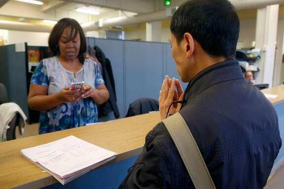 Associate registrar Patricia Gant helps Simon Chan get a refund after he was mistakenly charged tuition fees when registering for a sculpting class at CCSF in San Francisco, Calif. on Wednesday, Aug. 9, 2017. In an effort to boost enrollment, tuition fees will be waved for qualifying San Francisco residents for the next two academic years.
