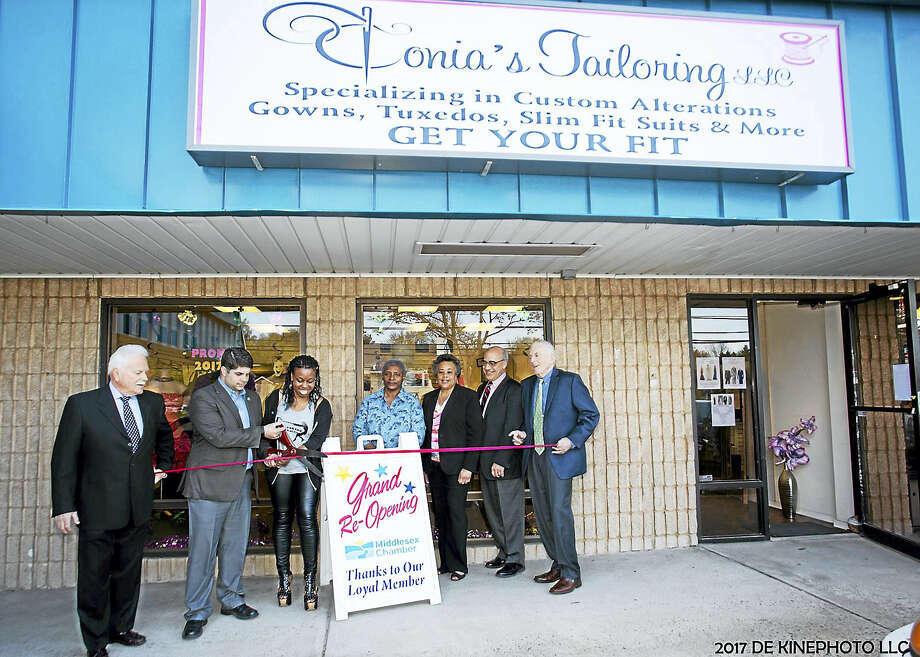 Tonia's Tailoring held a grand reopening April 18 at 749 Saybrook Road in Middletown. Shown are Middletown Small Business Development Counselor Paul Dodge, Mayor Dan Drew, owner Tonia Herring, Side Street to Main Street staff liaison Jennifer De Kine, Middletown Director of Equal Opportunity & Diversity Management Faith Jackson, Middletown Economic Development Specialist Thomas Marano and Larry McHugh. Photo: Courtesy De Kine Photo LLC   / (c)DE KINE PHOTO LLC