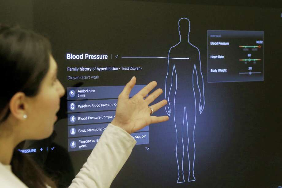 Dr. Aaliya Yaqub points to a large monitor while giving a demonstration of medical checkup at a Forward medical office in San Francisco. Photo: Jeff Chiu — The Associated Press  / Copyright 2017 The Associated Press. All rights reserved.