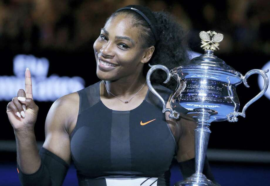 Serena Williams holds up her trophy after defeating her sister Venus in the women's singles final at the Australian Open. Photo: The Associated Press File Photo  / Copyright 2017 The Associated Press. All rights reserved.