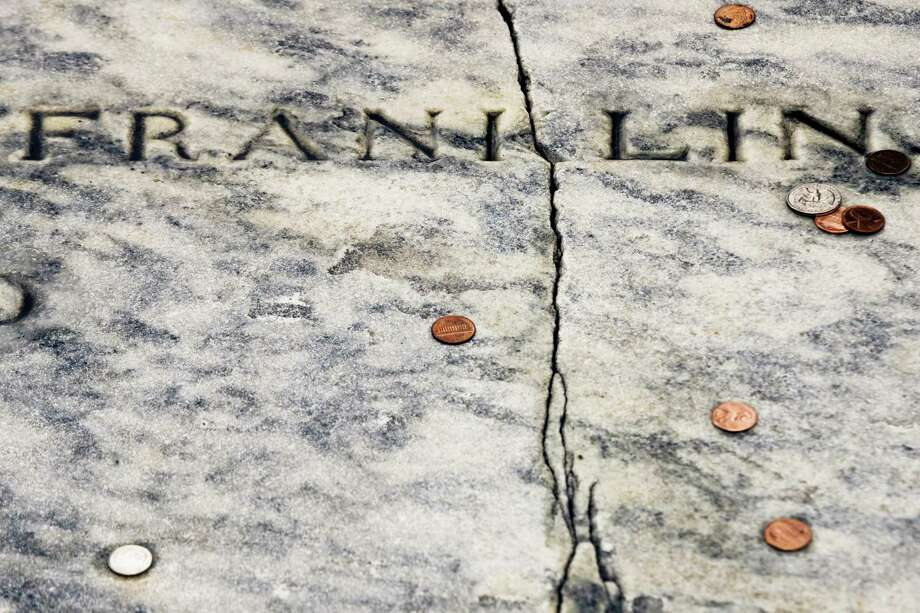 In this Tuesday, Nov. 15, 2016, file photo, a crack runs through Benjamin Franklin's a gravestone at the Christ Church Burial Ground in Philadelphia. Repairs are complete on Franklin's damaged gravestone. KYW-TV reported Christ Church will hold an unveiling Tuesday, May 23, 2017, of the repaired slab on the grave that holds Franklin and his wife, Deborah. Photo: AP Photo/Matt Rourke, File   / Copyright 2016 The Associated Press. All rights reserved.