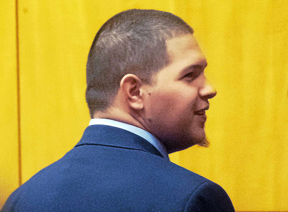 Moreno smiles as he sees members of his family Friday in court.