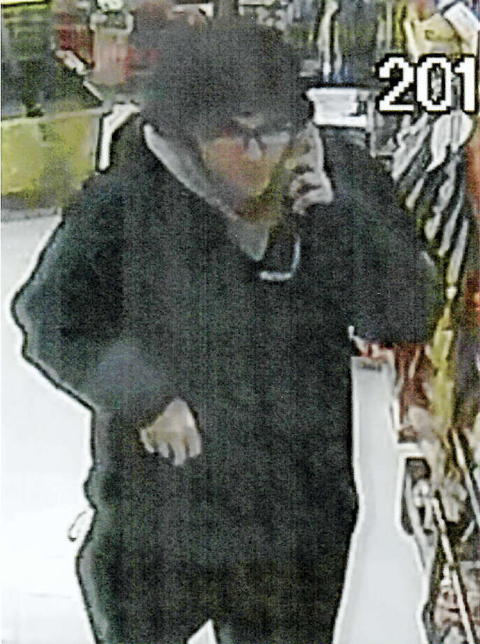 Connecticut State Police are hoping the public can help identify a suspect who they said used a credit card stolen from a victim's car in Durham to buy goods at a convenience store in Meriden early Friday. Photo: Courtesy State Police