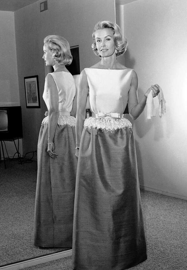 In this April 6, 1962, file photo, socialite-actress Dina Merrill models the gown she will wear at the Academy Awards presentation in Los Angeles. Merrill, the rebellious heiress who defied her super-rich parents to become an actress, died Monday, May 22, 2017, at age 93. Photo: AP Photo/Harold P. Matosian, File   / Copyright 2017 The Associated Press. All rights reserved.