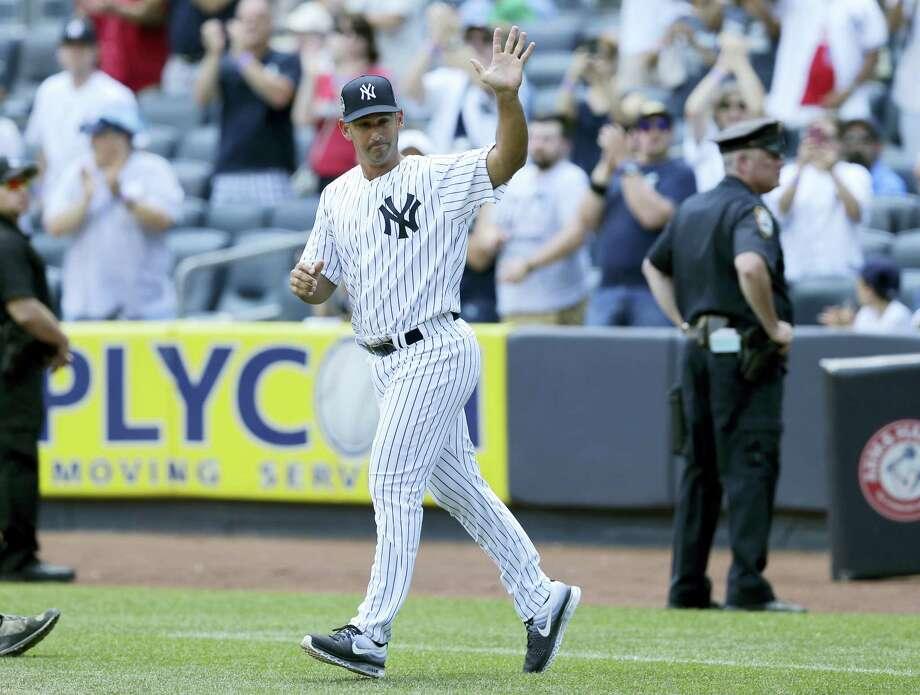 Former New York Yankee Jorge Posada waves during Old-Timers' Day at Yankee Stadium on Sunday. Photo: Seth Wenig — The Associated Press  / Copyright 2017 The Associated Press. All rights reserved.