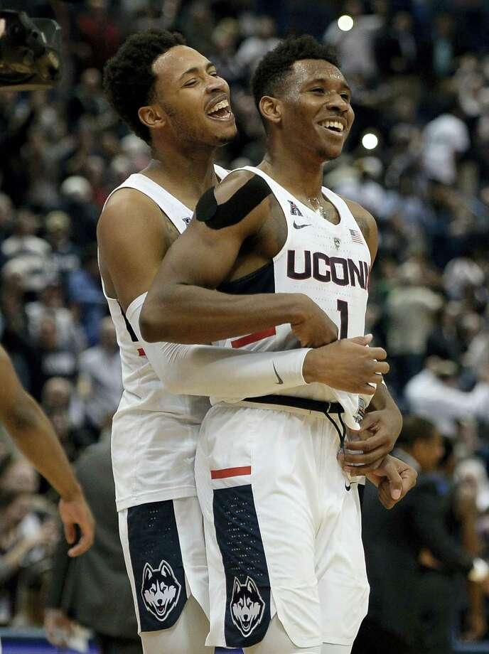 UConn's Jalen Adams, left, and Christian Vital celebrate their win over Memphis on Thursday. Photo: Jessica Hill — The Associated Press  / AP2017