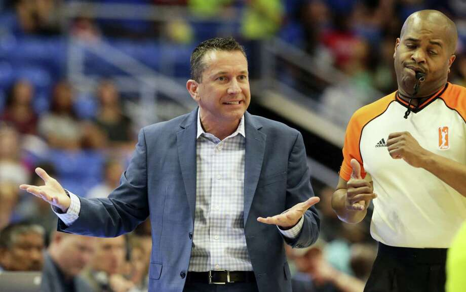 Connecticut Sun head coach Curt Miller, left, questions a call by referee Byron Jarrett during the first half of a WNBA basketball game against the Dallas Wings in Arlington, Texas, Sunday, June 25, 2017. (AP Photo/LM Otero) Photo: AP / Copyright 2017 The Associated Press. All rights reserved.