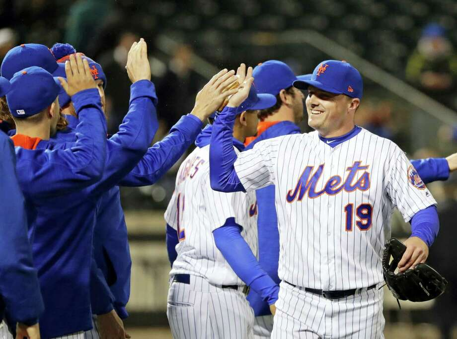 New York Mets' Jay Bruce (19) celebrates with teammates after a baseball game against the Philadelphia Phillies, Wednesday, April 19, 2017, in New York. The Mets won 5-4. (AP Photo/Frank Franklin II) Photo: AP / Copyright 2017 The Associated Press. All rights reserved.
