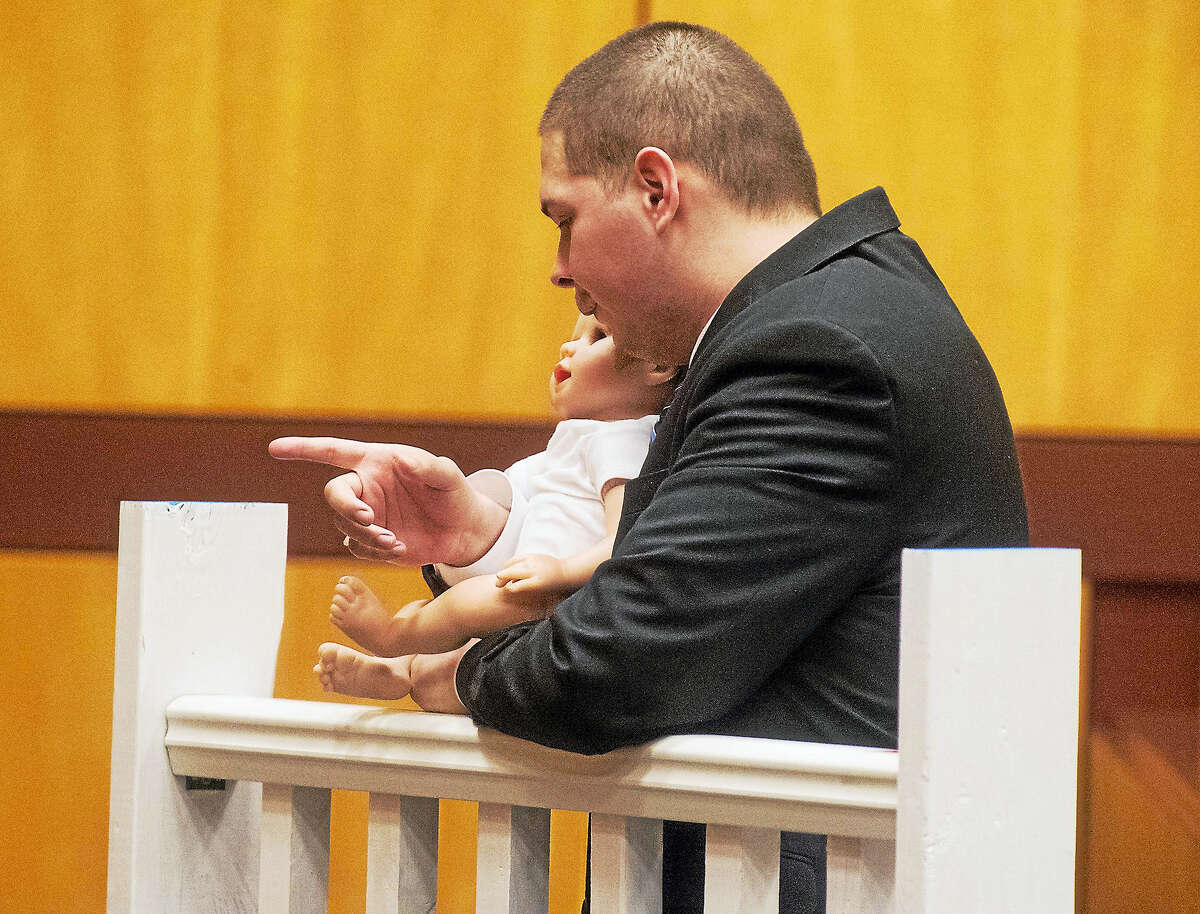 Patrick Raycraft — Hartford Courant, pool photo Tony Moreno demonstrates to the jury how he held his son Aaden on the railing of the Arrigoni Bridge in the final moments of Aaden's life on July 5, 2015.