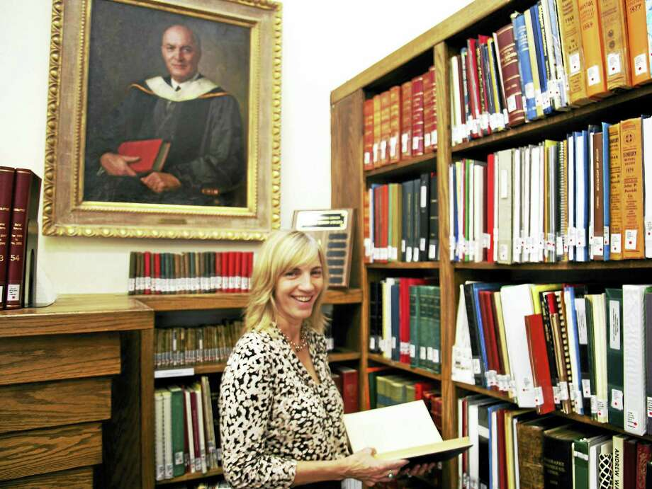 Executive Director of the Godfrey Memorial Library Beth Mariotti uncovered the U.S. citizenship papers of Carl Herrmann. Photo: Bob Crawshaw Photo