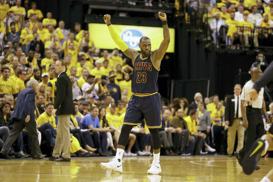 Cavaliers forward LeBron James celebrates a basket in the second half on Thursday. Photo: Michael Conroy — The Associated Press  / Copyright 2017 The Associated Press. All rights reserved.