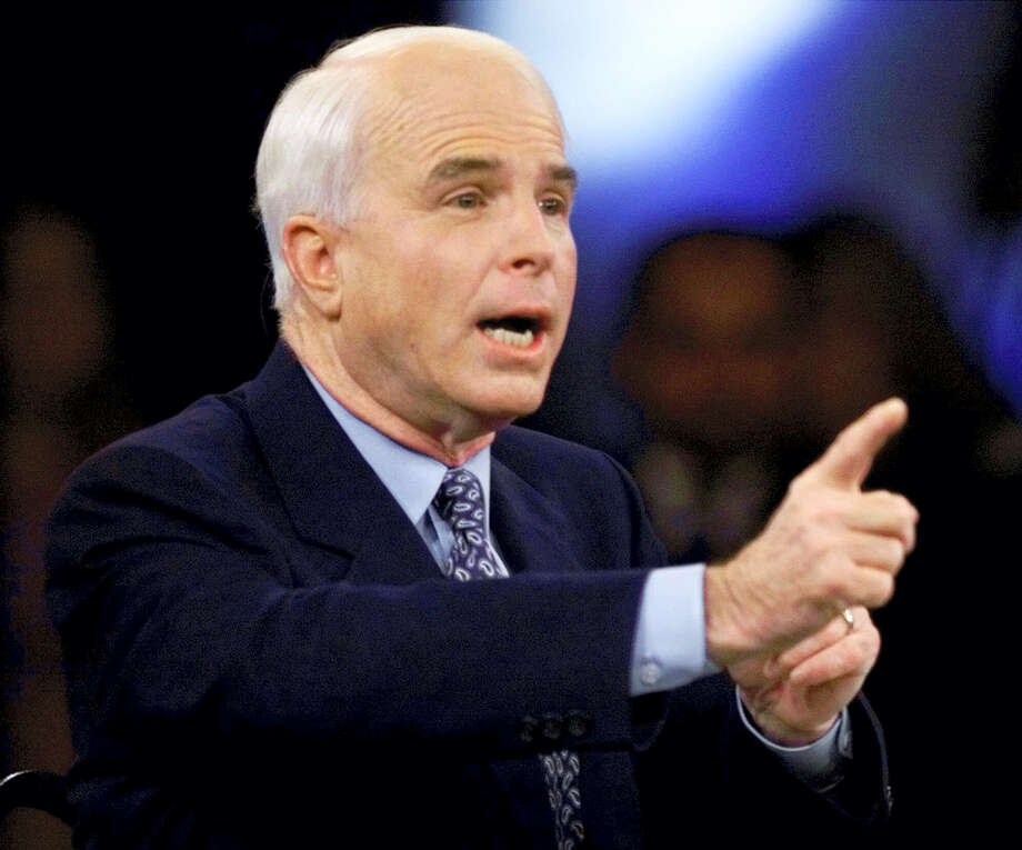 In this Feb. 15, 2000, file photo photo, then-Republican presidential candidate Sen. John McCain, R-Ariz., responds to a question during the Republican presidential debate sponsored by the South Carolina Business and Industry Political Education Committee, in Columbia, S.C. Photo: AP Photo / Eric Draper, Pool  / AP2000
