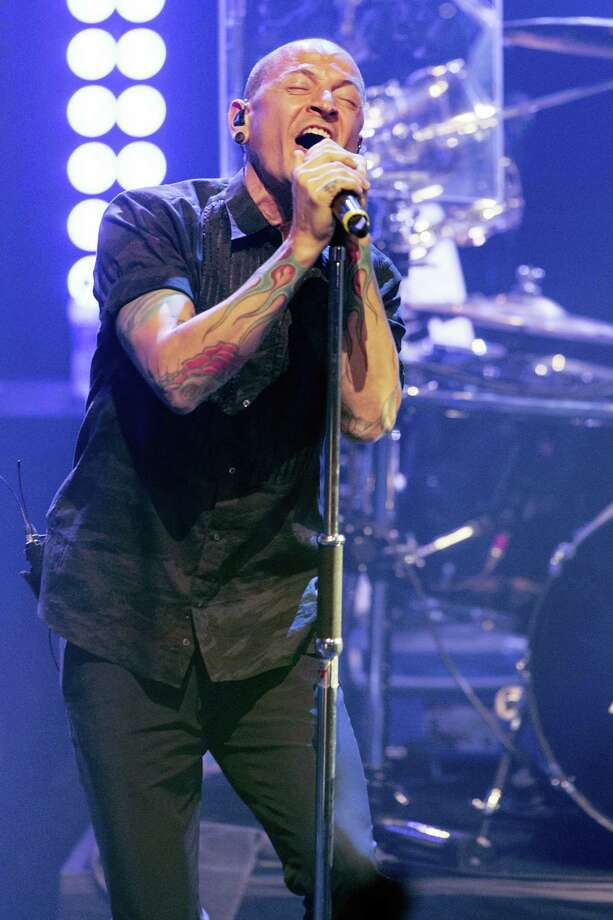 In this June 18, 2014 file photo, Chester Bennington of Linkin Park performs during the iHeartRadio Live Series in Burbank, Calif. The Los Angeles County coroner says Bennington, who sold millions of albums with a unique mix of rock, hip-hop and rap, has died in his home near Los Angeles. He was 41. Coroner spokesman Brian Elias says they are investigating Bennington'Äôs death as an apparent suicide but no additional details are available. Photo: Paul A. Hebert/Invision/AP, File  / Invision