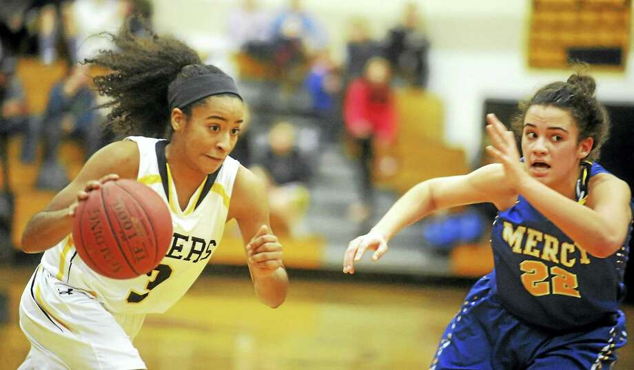Hand senior Gabby Martin looks to drive past Mercy senior Keri Kernisan on Monday night in Madison. Photo: Jimmy Zanor - The Middletown Press