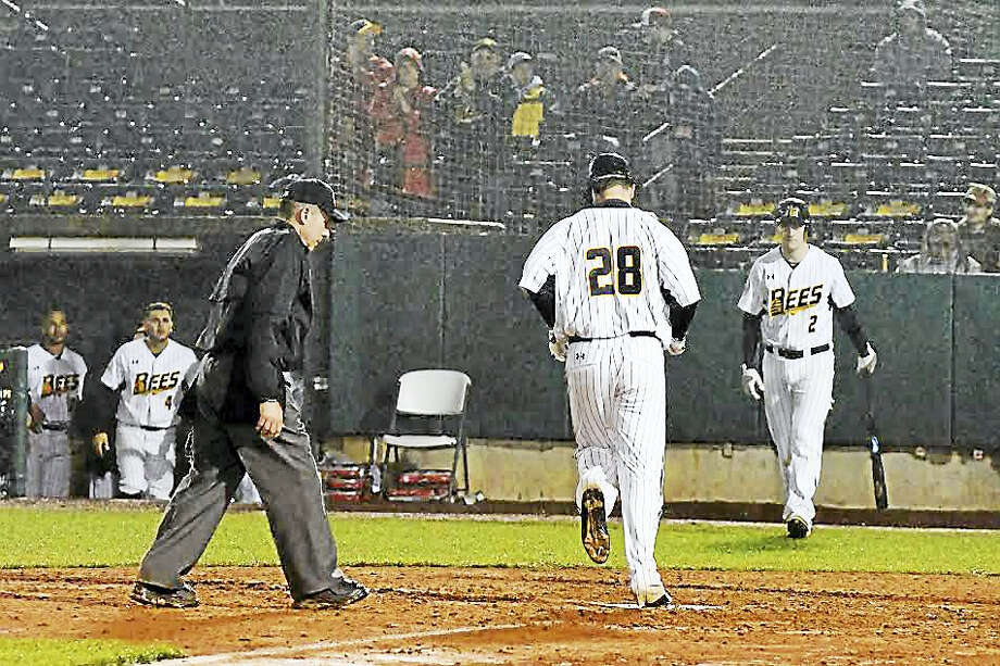 Torrington's Conor Bierfeldt crosses home plate after hitting one of his two homers in New Britain Bees' opening-night loss on April 21. Photo: Photo Courtesy Of New Britain Bees  / PREMIER_PORTRAITS_TWO_LLC_20166