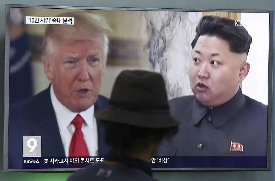 A man watches a television screen showing U.S. President Donald Trump, left, and North Korean leader Kim Jong Un during a news program at the Seoul Train Station in Seoul, South Korea Aug. 10. Can the president be trusted to have learned the lessons of history in dealing with this crisis. The Cuban Missile Crisis is analogous. Photo: Ahn Young-joon /Associated Press / Copyright 2017 The Associated Press. All rights reserved.