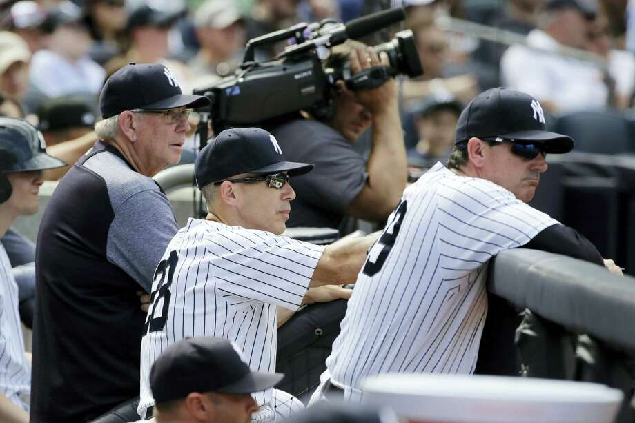 Yankees manager Joe Girardi, center, watches Tyler Clippard pitch during the ninth inning Saturday in New York. Photo: Frank Franklin II — The Associated Press  / Copyright 2017 The Associated Press. All rights reserved.