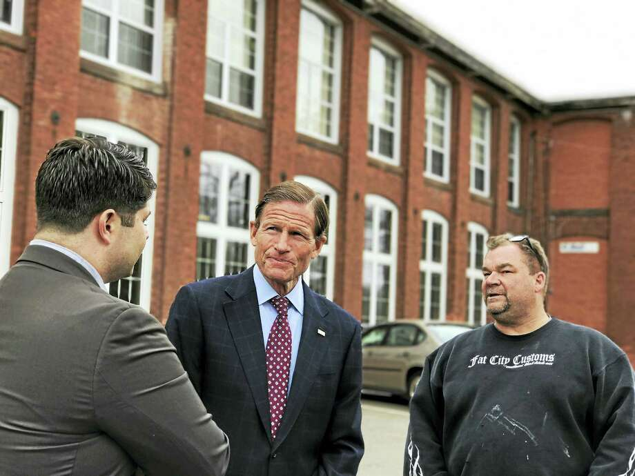Middletown Mayor Dan Drew, left, and U.S. Sen. Richard Blumenthal, center, walked around the former Remington Rand building on Wednesday, visiting businesses including Fat City Customs. Photo: Contributed Photo