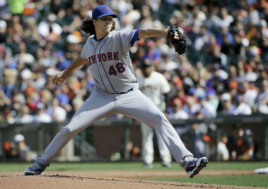 Mets pitcher Jacob deGrom throws against the Giants during the first inning Saturday. Photo: Jeff Chiu — The Associated Press  / Copyright 2017 The Associated Press. All rights reserved.