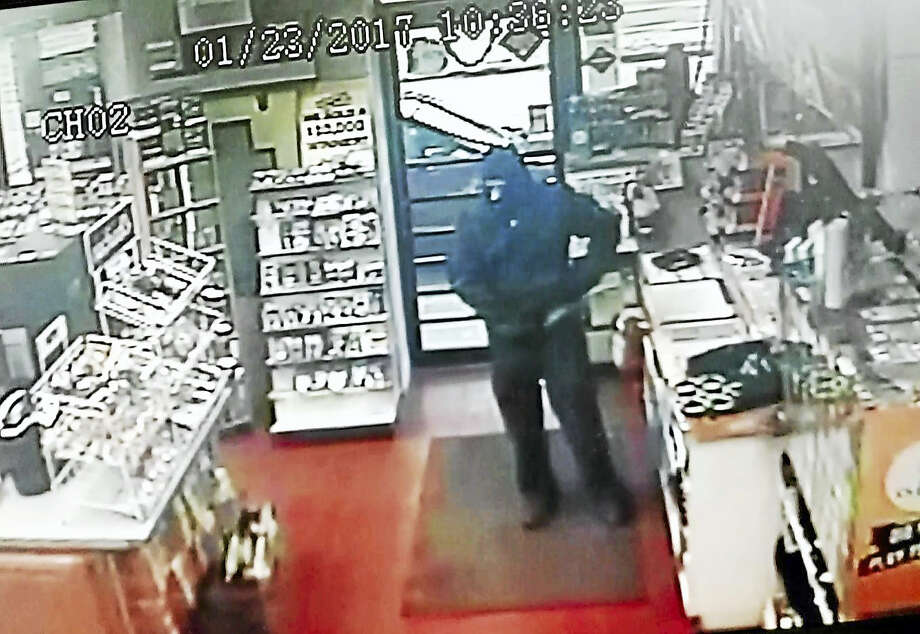 The Fuel Plus Station at 210 Saybrook Road in Haddam was robbed Monday at gun point, police say. A video surveillance still from the gas station shows the suspect, who authorities say left without taking anything. Photo: Courtesy State Police