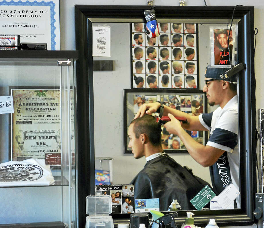 On Tuesday, Vargas' 19-year-old brother Jonathan Vargas got a quick touch-up with the clippers. Photo: Cassandra Day — The Middletown Press