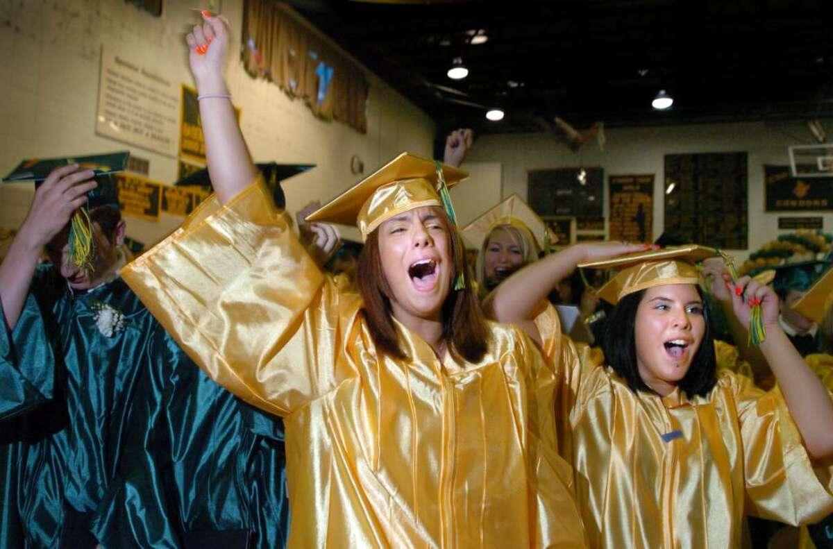 Graduates Lucia Johnson, of Ansonia, and Katelyn Rizzio, of Derby, celebrate after turning their tassels Wednesday June 16, 2010 during the Emmett O'Brien Technical High School commencement ceremony.
