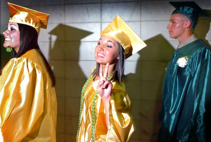 Brianna Weldon, of Seymour, flashes the peace sign as she waits in line to receive her diploma Wednesday June 16, 2010 during the Emmett O'Brien Technical High School commencement ceremony.