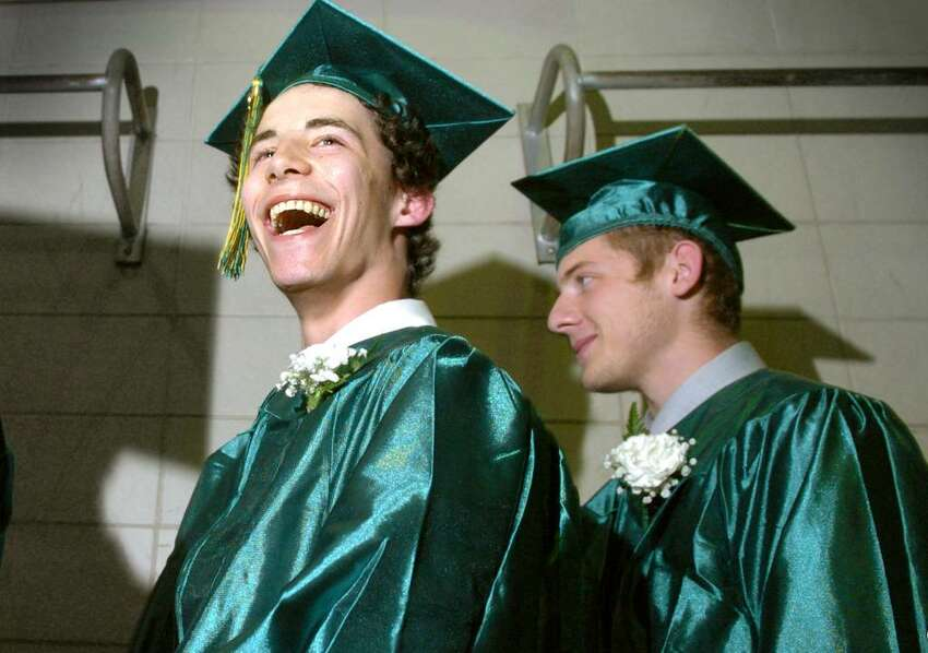 Graduate Thomas Laufer gives the crowd a big smile as he waits in line along with classmate Thomas Moscato Jr. to receive his diploma Wednesday June 16, 2010 during the Emmett O'Brien Technical High School commencement ceremony.