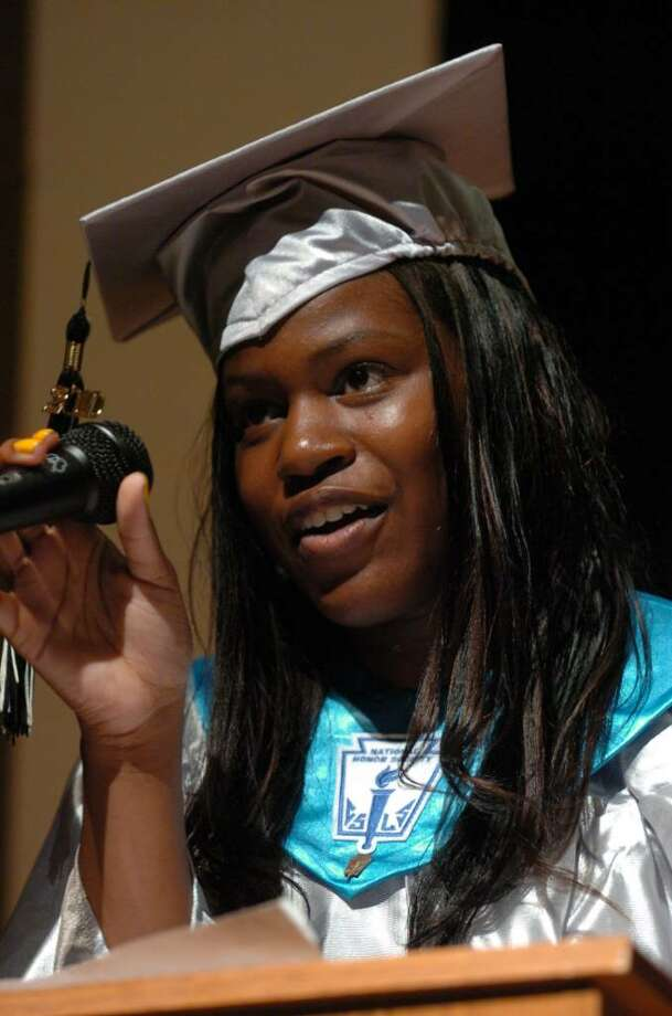 Highlights from Bridge Academy's 13th Annual Commencement Exercises held at Thurgood Marshall Middle School in Bridgeport, Conn. on Wednesday evening June 16, 2010. Here, graduate Alexis Chisolm gives the Valedictory Address. Photo: Christian Abraham / Connecticut Post