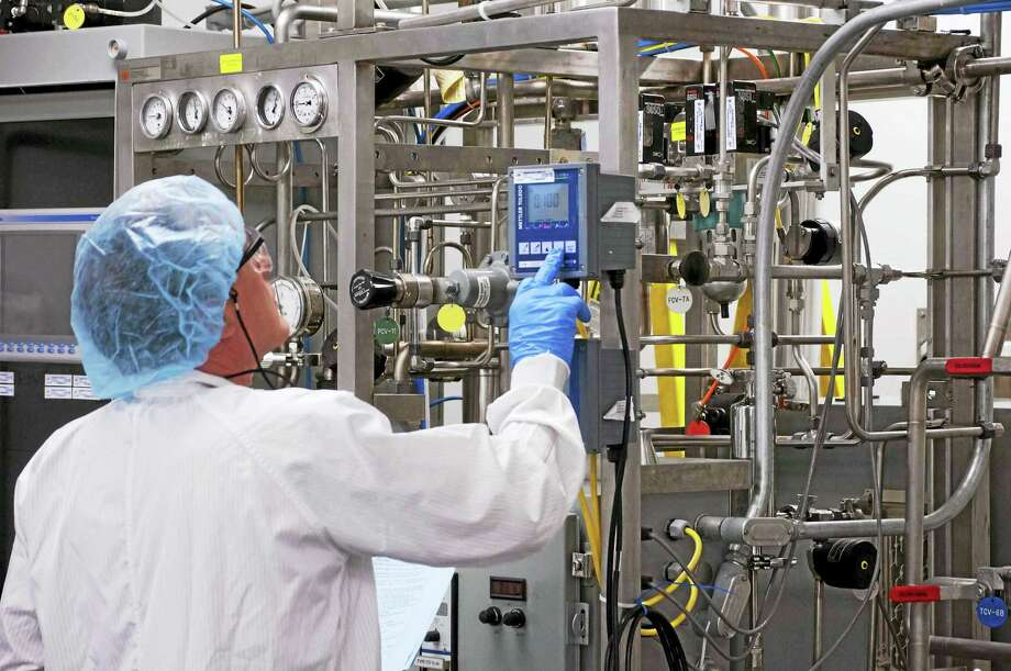 A worker manufacturing product for Flublok in Meriden. Photo: CONTRIBUTED PHOTO — Protein Sciences