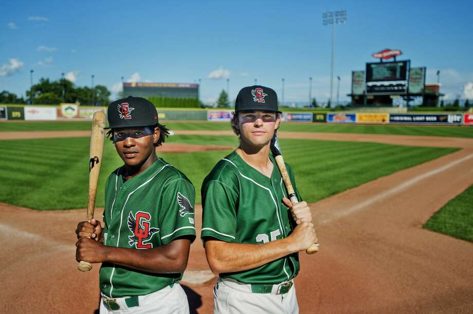 Great Lakes Loons right fielder Carlos Rincon, left, and center fielder Cody Thomas, right, pose for a portrait on Monday, August 7, 2017 at Dow Diamond. On August 3 in Dayton, Ohio, Rincon and Thomas became only the second pair of teammates know to have hit back-to-back homers twice in the same inning in professional baseball. Photo: (Katy Kildee/kkildee@mdn.net)