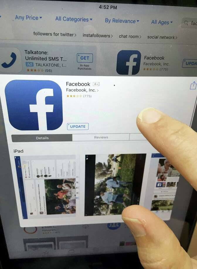 This Monday, June 19, 2017, photo shows Facebook launched on an iPhone, in North Andover, Mass. Facebook is working on a way for news organizations to charge readers for articles they share and read on the social network. Facebook's head of news partnerships, Campbell Brown, says the current plan is to require payments after reading 10 articles from a publisher through Facebook. Brown said at a conference in New York on Tuesday, July 18, 2017, that news organizations have been calling for subscription capabilities. Photo: Elise Amendola / The Associated Press / Copyright 2017 The Associated Press. All rights reserved.