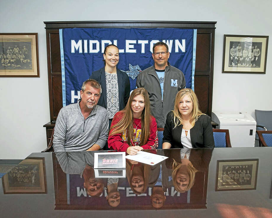 Sandy Aldieri / Perceptions PhotographyMiddletown senior softball player Kayla Pita, committing to attend Regis College, is seated with her father, Dale Pieta, and mother, Michelle Pieta. Standing are Middleotwn Athletic Director Elisha De Jesus and softball coach Sal Morello. Photo: Digital First Media